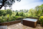 A picture of the hot tub, overlooking gardens